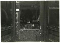 Girl at door, New York City tenement, Lewis Hine 1900's