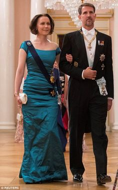 Crown Prince Pavlos of Greece and Jenni Haukio, wife of Finland's President Sauli Niinisto enter