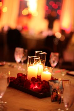 Simple. Candles and surround with carnations for budget. $25.00