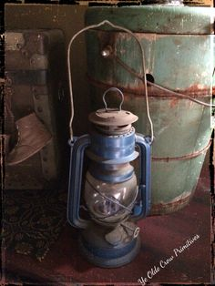 Beautiful old blue lantern, antique wooden ice cream maker, Old trunk and vintage baby shoes. Ye Olde Crow Primitives.