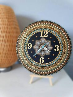 Check out this item in my Etsy shop https://www.etsy.com/listing/575963451/gold-mandala-wall-clock-original-hand