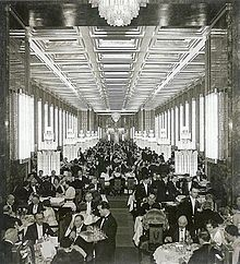 Normandie's main dining room, decorated with Lalique glass and compared to the Hall of Mirrors at Versailles