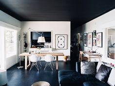 If you're a fan of black and white, then this monochromatic home is sure to fire your creative engines. That charcoal ceiling is everything.