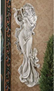 "30"" Classic Musical Beauty Feminine Wall Sculpture Statue Figurine Gift Item by XoticBrands. $118.29. Cast in quality designer resin. Classic Statues Sculptures. At 2½-feet-tall from her lyre to her flowing gown, the muse of music is an inspired mythological vision for home or gallery wall. the artist wrapped this Sapphic beauty in flowers and yards of sheer gossamer before casting her in quality designer resin and capturing her every detail in an antique stone finish.14""Wx3""D..."