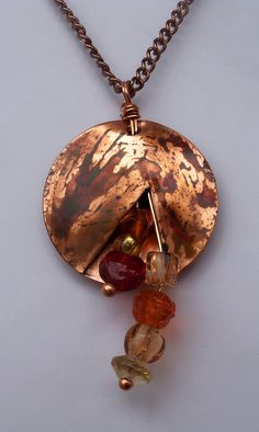 Copper discs torch colored with Chez glass by DreamCornerJewelry,