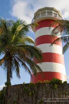 Grand Bahama Island, The Bahamas; Lucaya Lighthouse and cloud formations lit up by late afternoon sunlight