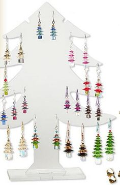 Gallery of Designs > Christmas Tree Earrings with Swarovski Elements - Add sparkle and cheer to your holiday sales with hot-selling Christmas tree earring designs. Created with sparkling SWAROVSKI ELEMENTS available at the lowest wholesale prices, these simple yet spectacular Christmas tree earrings are easy to make, sell and wear. View the 68 FREE design ideas and be inspired to create your own versions of these show-stopping earrings.