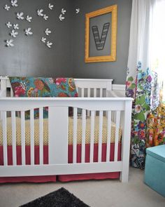 Nursery Reveal: Vera's Grey and Colorfully Unique Room | Baby Lifestyles.  Love the bright colors...I woud use a lighter shade in place of the gray.