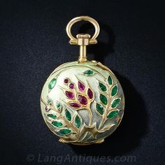 An absolutely splendid, one-of-a-kind, ladies pendent watch circa 1900. The background is matte finished enamel which subtly gradates from b...