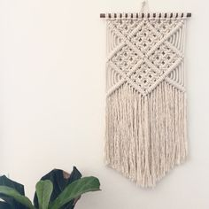 This modern macrame wall hanging is set on wood dowel with high quality 100% cotton rope. Offering 3 different versions. This piece can be cut to a point or straight across! Just specify when buying. Thanks!   ~ 28 inches + fringed ends on 15 inch dowel. Fringed ends offers a boho look. This look is much more time consuming which is why it is extra but end result is so worth it!  ~ 41 inches long on 15 inch wood dowel.  ~ 28 inches long on a 15 inch dowel.    This piece is sure to bring…