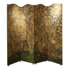 Pair of Chinese Wallpaper Screens  China  e. 19th Century  A fabulous pair of large four panels screen, with a vibrantly painted antique Chinese wallpaper on the fronts.    Screens have elegant curved tops, and the backs are painted with simple borders.    This wallpaper originally hung in the dining room of Gloria Vanderbilt and Wyatt Cooper.