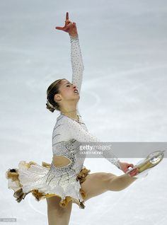 Italy's Carolina Kostner performs her free program at the Hartwall Areena in Helsinki, on January 24 during the European Figure Skating Championships. Carolina Kostner, Daily Burn, Figure Skating Dresses, Ice Skating, Squats, Fitspo, Champion, Italy, Exercise