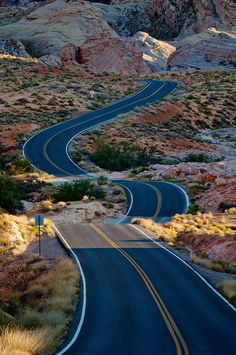 Ribbon of Adventure, Valley of Fire State Park, Nevada. Turn off this road and visit Valley of the Fire. Most spectacular, under-rated rock formations you will ever see. Rainbow hills, huge rocks of orange color, white sands and a surprise of a different color around every curve.