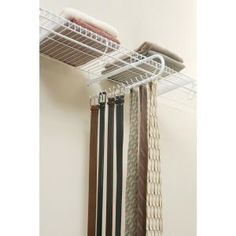 If you opt for a rubbermaid closet system, you could add this on for storing belts. Rubbermaid - Sliding Tie & Belt Rack Support - - Home Depot Canada Belt Storage, Scarf Storage, Closet Storage, Closet Shelving, Garage Storage, Kitchen Storage, Belt Rack, Tie Rack, Belt Holder
