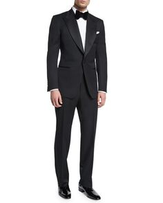 "Tom Ford ""Windsor"" base tuxedo. Black grosgrain peak lapel. Grosgrain-covered single-button front. Front besom pockets with grosgrain detail; hand-stitched chest welt pocket. Double vented back. Signa"