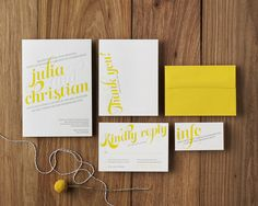 Letterpress wedding stationery suite in yellow, silver, and white.