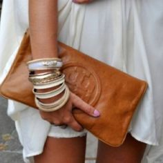 Luv this leather Tory Burch clutch!