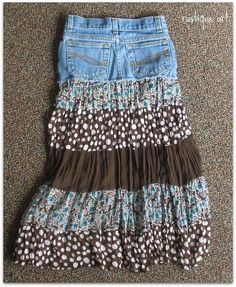 Recycle your old blue jeans into a skirt.  This skirt uses one pair of blue jeans and an dress, both were recycled to make this adorable skirt!