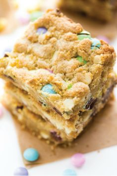 These Spring Cookie Bars are just the thing you need to wash those rainy day blues away. Packed with colorful chocolate candies, white chocolate chips, and soft, creamy butter, these cookie bars are just what the doctor ordered.