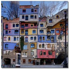 This is Hundertwasser Haus. It is located in the 3rd district in the Löwengasse, Vienna.