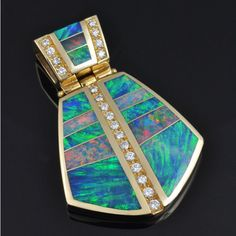 Australian opal pendant featuring top quality opal and diamonds set in 14k yellow gold by The Hileman Collection.  This opal pendant is real show-stopper and is even more impressive in person.  $19,800