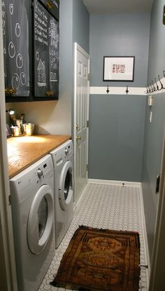 DREAM laundry room!  Chalkboard cabinets for notes, table top for folding, and hooks to hang your non dry-able items!
