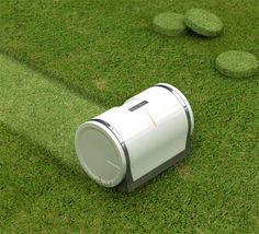 """Muwi"" sizes the yard and automatically cuts the grass. The cut grass is stored inside. As the cut grass begins to accumulate inside the machine, ""Muwi"" constructs and compresses the cut grass into two types of blocks... discs or balls... play time!"