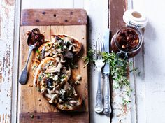 Toast topped with wild mushrooms and various greens and sprouts