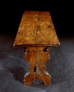 """Gothic, elm trestle table, circa 1520. The top is made from two 9ft long boards, which are 2"""" thick, displaying the fine grain of the Elmwood to full advantage. Apart from old repairs to the mortice joints, a couple of small patches to worm damage, and minor nibbles, the table has survived in remarkable authentic condition due to the fact that it has, most likely, stood in The Old Hall at Rothamsted Manor for most of its life."""