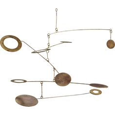 Shop crop circle mobile.   Handmade free floating sculpture hangs in the balance.  Iron rings and discs weld to slimline spokes then stagger light-as-air in layers that twist and turn 360 degrees.