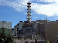 Chernobylreactor_1.jpg.  Chernobyl power plant in 2003 with the sarcophagus containment structure