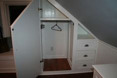closet for a room with angled ceiling.better use of dead space in tiny closet corner
