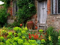 March 9, 1892 renowned gardener Vita Sackville-West was born.  Pictured here is a glimpse of the Sissinghurst Gardens she designed.