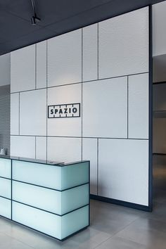 LEVELe Wall Cladding System with customized mounting; insets in Bonded Quartz, White with Crinkle pattern at Spazio, Pune, Maharashtra, India