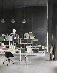 Stunning black workspace with Muuto furniture. Stacked fiber chair in black and unfold lamp.
