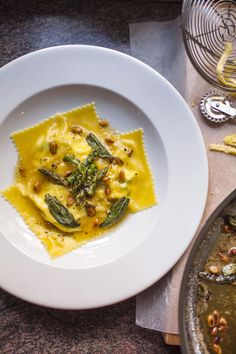 Haloumi, ricotta and asparagus ravioli using wonton wrapper served with burnt butter sauce with sage and pine nuts