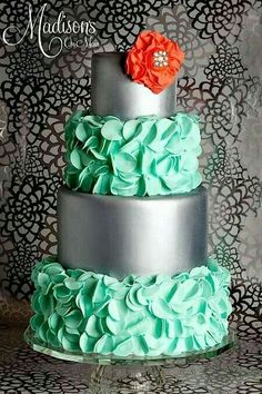 Aqua ruffle silver cake with coral flower. Beautiful tier cake.