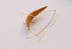 Olive Wood and Silver Brooch - Trapped Collection Photo Credit: Nicholas Stavropoulos Silver Brooch, Photo Credit, Jewelry Collection, Wood, Woodwind Instrument, Wood Planks, Trees, Home Decor Trees