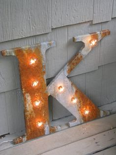"Is this . . . the letter ""K"" or maybe - a reindeer saying to the letter ""I"".  Can we be friends?"