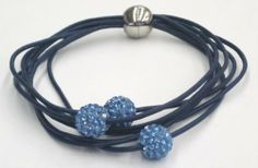 Navy Blue Multi Strand Leather Bracelet with Light Blue Pave Crystal Disco Balls. Magnetic Easy Closure. 8 Inch Length. Pavel Steel. $14.99. Magnetic Closure for Easy Self-Closing; 7 Leather Strands; 3 Light Blue Pave Crystal Disco Balls; Gift Box Included; Fits Average Size Women's Wrist. Save 52% Off!