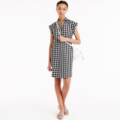 """A classic shirtdress made from crisp cotton in our favorite pattern of the season: gingham. We gave it a straight body-skimming fit with a curved hem and rolled sleeves, so it's the perfect combination of flattering, feminine and timeless. This is how you do polished and easy in 60 seconds flat. <ul><li>Straight silhouette.</li><li>Falls above knee, 36"""" from high point of shoulder (based on size 6).</li><li>Cotton.</li><li>Button closure.</li><li>Patch pockets.</li><li>Machine…"""