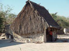 Girl by a hut - Muchacha en frente de una casa; Lázaro Cardenas, Región Istmo, Oaxaca, Mexico