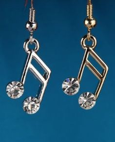 More music to my ears:  Music Note Earrings. Earrings are small music notes with a white rhinestone at the end of each note. Come in gold and silver brushed