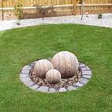 #Solarpowered sandstone water feature with LED light. #sustainable #landscapedesign