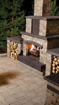 Transform your backyard into an outdoor escape. The Stone Oasis Fireplace offers ample storage for your firewood under three tiers of statement-making stone. Shown: Stone Oasis Fireplace kit in Sierra Grey, Roman Pavers in Sierra Grey Diy Outdoor Fireplace, Backyard Fireplace, Fire Pit Backyard, Backyard Patio, Backyard Ideas, Garden Ideas, Outdoor Life, Indoor Outdoor, Outdoor Decor