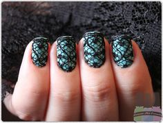 Love it! Lace over polish. Coat with clear to get it to stick.