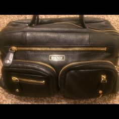 DKNY Black leather handbag DKNY gorgeous black leather handbag. The bag has minor scuffs and marks. Offers are welcome! DKNY Bags Shoulder Bags