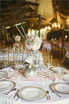 Metal rod teepee wedding centerpiece @weddingchicks