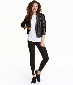 Black. Leggings in jersey with imitation suede at front. High waist and an elasticized waistband.