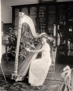 Miss Mawhimey playing Harp created between 1905 and 1945 by Harris & Ewing
